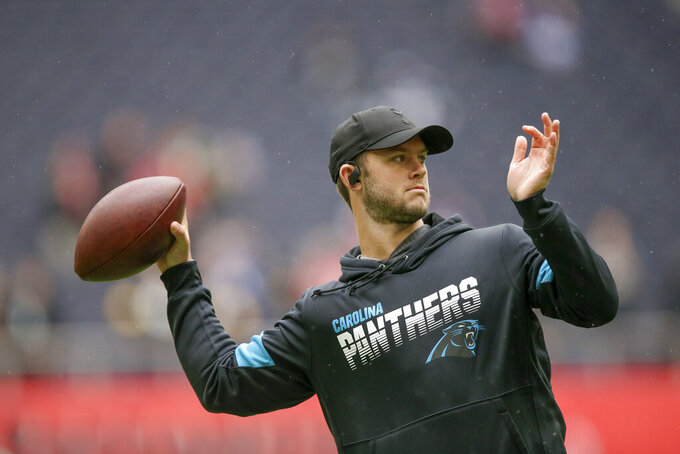 Carolina Panthers quarterback Kyle Allen warms up before an NFL football game against the Tampa Bay Buccaneers, Sunday, Oct. 13, 2019, at Tottenham Hotspur Stadium in London. (AP Photo/Tim Ireland)