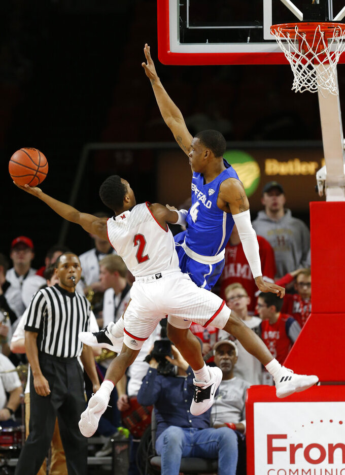 Miami (Ohio) guard Mekhi Lairy (2) puts up a shot against Buffalo guard Davonta Jordan (4) during the first half of an NCAA college basketball game, Friday, March 1, 2019, in Oxford, Ohio. (AP Photo/Gary Landers)