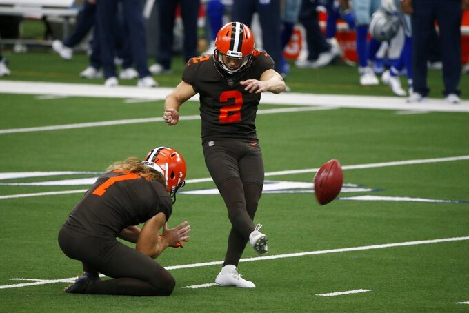 Cleveland Browns' Jamie Gillan (7) holds as Cody Parkey (2) kicks a field goal in the second half of an NFL football game agains the Dallas Cowboys in Arlington, Texas, Sunday, Oct. 4, 2020. (AP Photo/Michael Ainsworth)