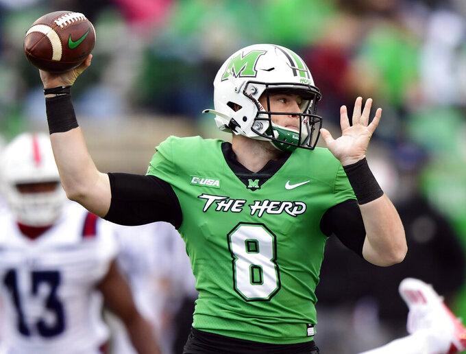 FILE - In this Oct. 24, 2020, file photo, Marshall Thundering Herd quarterback Grant Wells (8) makes a pass during an NCAA football game against the Florida Atlantic Owls on Saturday, Oct. 24, 2020 in Huntington, W.Va. Wells hopes to lead Marshall to a return to the Conference USA championship game, where the Thundering Herd lost a year ago to UAB. (AP Photo/Emilee Chinn, File)