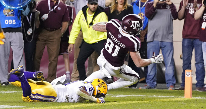 Texas A&M tight end Jace Sternberger (81) makes a for a touchdown as LSU safety Grant Delpit (9) defends during the first half of an NCAA college football game Saturday, Nov. 24, 2018, in College Station, Texas. (AP Photo/David J. Phillip)