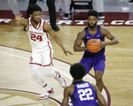 TCU's Mike Miles (1) passes the ball to RJ Nembhard (22) and away from Oklahoma's Elijah Harkless (24) during the second half of an NCAA college basketball game in Norman, Okla., Tuesday, Jan. 12, 2021. (AP Photo/Garett Fisbeck)