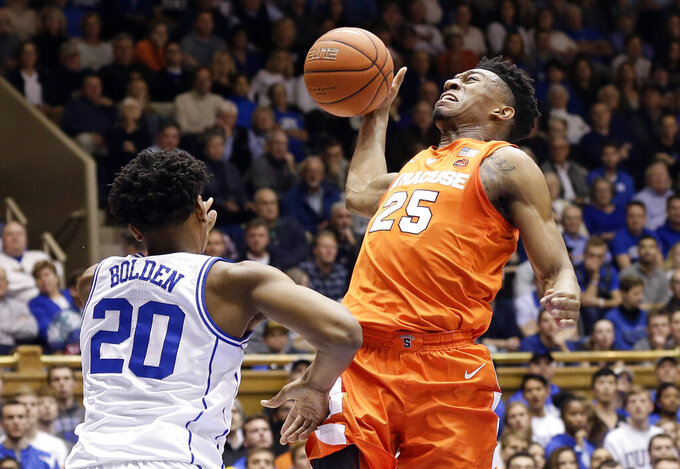 Duke's Marques Bolden (20) defends while Syracuse's Tyus Battle (25) drives to the basket during the first half of an NCAA college basketball game in Durham, N.C., Monday, Jan. 14, 2019. (AP Photo/Gerry Broome)