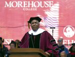 FILE - In this May 19, 2019, file photo, billionaire technology investor and philanthropist Robert F. Smith announces he will provide grants to wipe out the student debt of the entire 2019 graduating class at Morehouse College in Atlanta. DOJ charges Houston billionaire Robert Brockman, not seen, with $2 billion tax fraud in largest such fraud case against an American. Prosecutors also announced Thursday, Oct. 15, 2020, that Robert Smith, founder and chairman of investment firm Vista Equity Partners, will cooperate in the investigation and pay $139 million to settle a tax probe. (Steve Schaefer/Atlanta Journal-Constitution via AP, File)
