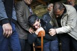 The father of 7-year-old Aysu Isgandarova, who died during shelling by Armenian forces in the struggle over the region of Nagorno-Karabakh, mourns during her funeral in Garayusifli, Azerbaijan, on Oct. 28, 2020. (AP Photo/Aziz Karimov)