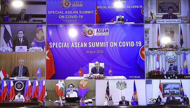 This image taken in Hanoi, Vietnam, shows a monitor screen of ASEAN leaders attending the Special ASEAN summit on COVID-19 online Tuesday April 14, 2020. Counter-clockwise from top left: ASEAN Secretary General Lim Jock Hoi, Thai President Prayut Chan-ocha, Singaporean President Lee Hsien Loong, Philippine President Rodrigo Duterte, Myanmar State Counsellor Aung San Suu Kyi, Malaysia Prime Minister Muhyiddin Yassin, Indonesian President Joko Widodo, Laos Prime Minister Thongloun Sisoulith, Cambodian Prime Minister Hun Sen, Brunei Sultan Hassanal Bolkiah and Vietnamese Prime Minister Nguyen Xuan Phuc. (VNA via AP)