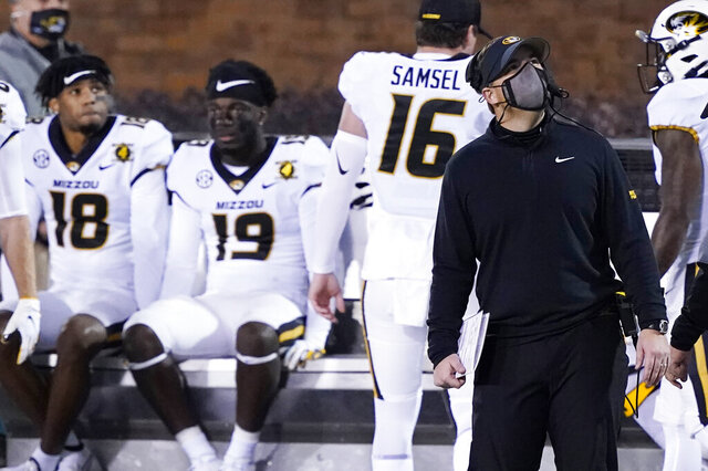 Missouri head coach Eliah Drinkwitz, right, looks at the scoreboard in the second half of an NCAA college football game against Mississippi State, Saturday, Dec. 19, 2019, in Starkville, Miss. (AP Photo/Rogelio V. Solis)