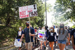 FILE - In this Sept. 7, 2020, file photo, Des Moines Public School students and supporters march from Roosevelt High School to the Governor's Mansion at Terrace Hill to protest the cancellation of fall and winter extracurriculars, in Des Moines, Iowa. All in-person activities were suspended this month as the district's classroom instruction remains virtual. (Olivia Sun/The Des Moines Register via AP, File)