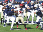 FILE - In this Nov. 23, 2019, file photo, Harvard's Devin Darrington runs against Yale during the first half of an NCAA college football game in New Haven, Conn. The Ivy League has canceled all fall sports because of the coronavirus pandemic.  (Arnold Gold/New Haven Register via AP, File)