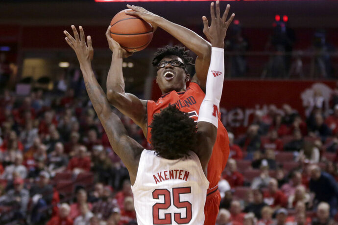 Maryland's Jalen Smith, top, goes for a basket against Nebraska's Nana Akenten (25) during the first half of an NCAA college basketball game in Lincoln, Neb., Wednesday, Feb. 6, 2019. (AP Photo/Nati Harnik)