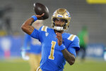 UCLA quarterback Dorian Thompson-Robinson warms up before an NCAA college football game against Fresno State on Saturday, Sept. 18, 2021, in Pasadena, Calif. If anyone symbolizes the rollercoaster that has been UCLA football during the Chip Kelly era it is quarterback Dorian Thompson-Robinson. (AP Photo/Marcio Jose Sanchez)