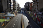 A highway is almost empty of cars during a lockdown aimed at curbing the spread of the coronavirus, in Beirut Lebanon, Thursday, Jan. 21, 2021. Authorities on Thursday extended a nationwide lockdown by a week to Feb. 8 amid a steep rise in coronavirus deaths and infections that has overwhelmed the health care system. (AP Photo/Bilal Hussein)