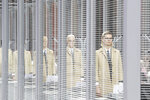 Models wear creations as part of the Thom Browne ready to wear Fall-Winter 2019-2020 collection, that was presented in Paris, Sunday, March 3, 2019. (AP Photo/Thibault Camus)