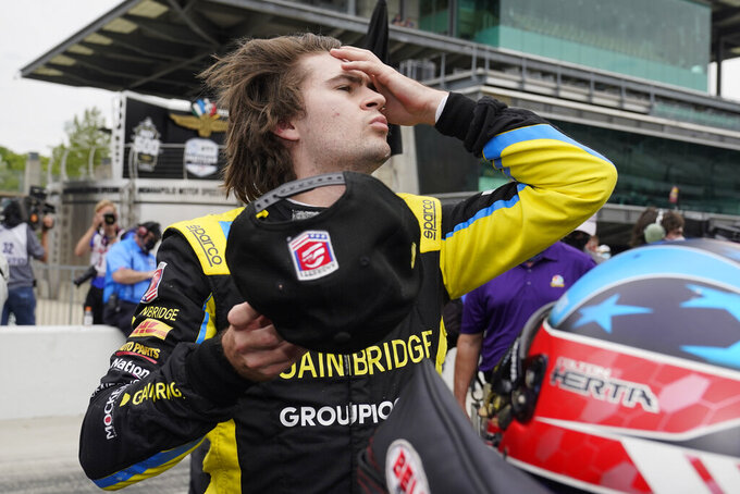 Colton Herta looks at the speed chart during qualifications for the Indianapolis 500 auto race at Indianapolis Motor Speedway, Saturday, May 22, 2021, in Indianapolis. (AP Photo/Darron Cummings)