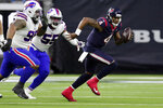 Houston Texans quarterback Deshaun Watson (4) breaks away from Buffalo Bills defensive end Jerry Hughes (55) and defensive tackle Star Lotulelei (98) during the second half of an NFL wild-card playoff football game Saturday, Jan. 4, 2020, in Houston. (AP Photo/Michael Wyke)