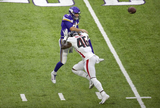Minnesota Vikings quarterback Kirk Cousins (8) is hit, forcing an incomplete pass, by Atlanta Falcons linebacker Edmond Robinson (46) in the first quarter of an NFL football game in Minneapolis, Sunday, Oct. 18, 2020. (Jerry Holt/Star Tribune via AP)