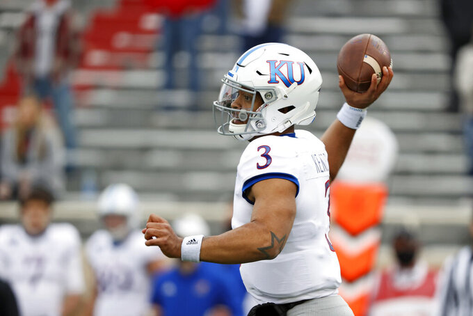 Kansas' Miles Kendrick (3) passes the ball during the first half of an NCAA college football game against Texas Tech, Saturday, Dec. 5, 2020, in Lubbock, Texas. (AP Photo/Brad Tollefson)