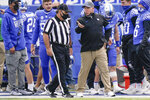 Kentucky head coach Mark Stoops speaks with an official during the first half of an NCAA college football game against Vanderbilt, Saturday, Nov. 14, 2020, in Lexington, Ky. (AP Photo/Bryan Woolston)