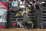 In this photo provided courtesy of the PBR/Bull Stock Media shows Amadeu Campos Silva rides the bull Yippee High Cowboy in Grand Rapids, Mich., in August, 2021. The Brazilian bull rider was killed Sunday, Aug. 29, 2021, when his spur got caught in a rope, pulling him under the bull, and the animal stepped on his chest in California, according to the Professional Bull Riders touring group. Silva, 22, was competing at a bull-riding Velocity Tour event at the Save Mart Center in Fresno, said Andrew Giangola, a spokesperson for Professional Bull Riders. He was pronounced dead at a hospital. (Andre Silva/Courtesy PBR/Bull Stock Media via AP)
