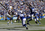 Indianapolis Colts free safety Malik Hooker, right, intercepts a pass intended for Los Angeles Chargers wide receiver Keenan Allen, left, during the second half in an NFL football game Sunday, Sept. 8, 2019, in Carson, Calif. (AP Photo/Marcio Jose Sanchez)