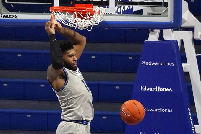 Saint Louis' Hasahn French dunks during the first half of an NCAA college basketball game against the Dayton Tuesday, Jan. 26, 2021, in St. Louis. (AP Photo/Jeff Roberson)