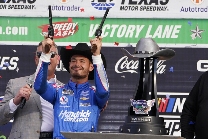 Kyle Larson (5) celebrates after winning a NASCAR Cup Series auto race at Texas Motor Speedway Sunday, Oct. 17, 2021, in Fort Worth, Texas. (AP Photo/Larry Papke)