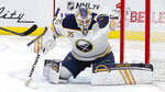 Buffalo Sabres goaltender Linus Ullmark (35) stops a Detroit Red Wings shot in the second period of an NHL hockey game Friday, Oct. 25, 2019, in Detroit. (AP Photo/Paul Sancya)