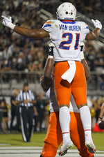 Boise State running back Andrew Van Buren (21) celebrates his 3-yard touchdown run against Central Florida with a teammate during the first half of an NCAA college football game Thursday, Sept. 2, 2021, in Orlando, Fla. (AP Photo/John Raoux)