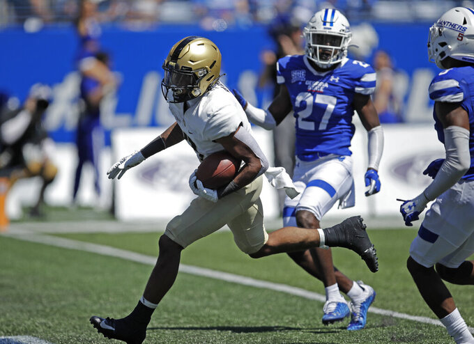 Army running back Braheam Murphy, left, runs past Georgia State's Jaylon Jones (27) to score a touchdown during the second half of an NCAA football game Saturday, Sept. 4, 2021, in Atlanta. (AP Photo/Ben Margot)
