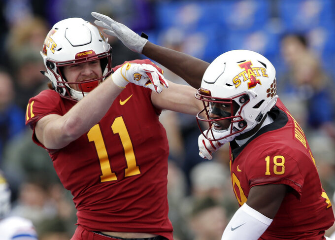 Iowa State tight end Chase Allen (11) congratulates wide receiver Hakeem Butler (18) on his touchdown during the first half of an NCAA college football game against Kansas in Lawrence, Kan., Saturday, Nov. 3, 2018. (AP Photo/Orlin Wagner)