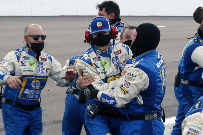 Crew Chief Alan Gustafson, center, celebrates with members of the pit crew after Chase Elliott's season championship victory in the NASCAR Cup Series auto race at Phoenix Raceway, Sunday, Nov. 8, 2020, in Avondale, Ariz. (AP Photo/Ralph Freso)