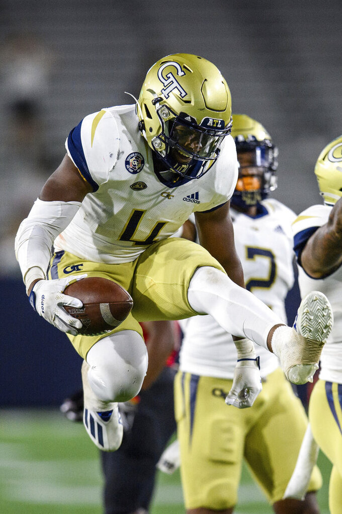 Georgia Tech linebacker Quez Jackson (4) celebrates a fumble recovery during the second half of the team's NCAA college football game against Northern Illinois on Saturday, Sept. 4, 2021, in Atlanta. (AP Photo/Danny Karnik)