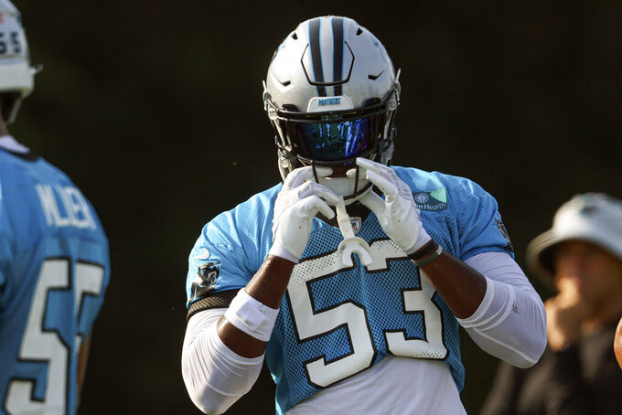 Carolina Panthers defensive end Brian Burns adjusts his helmet during practice at the NFL football team's training camp in Spartanburg, S.C., Thursday, July 29, 2021. (AP Photo/Nell Redmond)