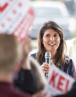 FILE - In this Dec. 20, 2020, file photo, former South Carolina Governor and former U.N. Ambassador Nikki Haley speaks at a rally in Evans, Ga. South Dakota Gov. Kristi Noem criticized a Texas school's food pantry to take a shot at fellow Republican Haley, a move that political strategists saw as an early tussle between a pair of potential presidential hopefuls. (Michael Holahan/The Augusta Chronicle via AP, File)