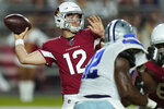 Arizona Cardinals quarterback Colt McCoy (12) throws against the Dallas Cowboys during the first half of an NFL preseason football game, Friday, Aug. 13, 2021, in Glendale, Ariz. (AP Photo/Ross D. Franklin)