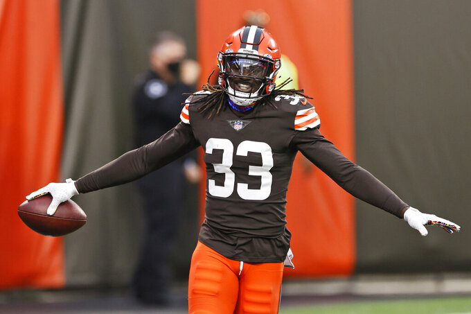 Cleveland Browns defensive back Ronnie Harrison celebrates after a 47-yard interception return for a touchdown during the second half of an NFL football game against the Indianapolis Colts, Sunday, Oct. 11, 2020, in Cleveland. (AP Photo/Ron Schwane)