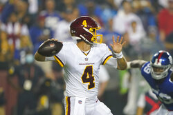 Washington Football Team quarterback Taylor Heinicke (4) passes the ball against the New York Giants during the first half of an NFL football game, Thursday, Sept. 16, 2021, in Landover, Md. (AP Photo/Al Drago)