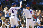 Chicago Cubs' Nicholas Castellanos (6) celebrates with teammate Kyle Schwarber right, after scoring on a Kris Bryant single during the second inning of a baseball game against the Pittsburgh Pirates Saturday, Sept. 14, 2019, in Chicago. (AP Photo/Paul Beaty)