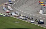 Cars file in behind the pace truck on pit road after the NASCAR Cup Series auto race was delayed because of inclement weather at Daytona International Speedway, Sunday, July 7, 2019, in Daytona Beach, Fla. (AP Photo/David Graham)