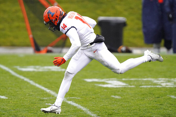 Illinois wide receiver Brian Hightower runs with the ball for a touchdown during the second half of an NCAA college football game against Northwestern in Evanston, Ill., Saturday, Dec. 12, 2020. Northwestern won 28-10. (AP Photo/Nam Y. Huh)