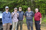 Tom Lewis of Liberty, right, serves as guide for Mississippi State University bear researchers, from left, Lacy Dolan, Carly Haywood, Thomas Rovery and Jacob Thacker in Amite County, Miss., on June 2, 2021. (Ernest Herndon/The Enterprise-Journal via AP)