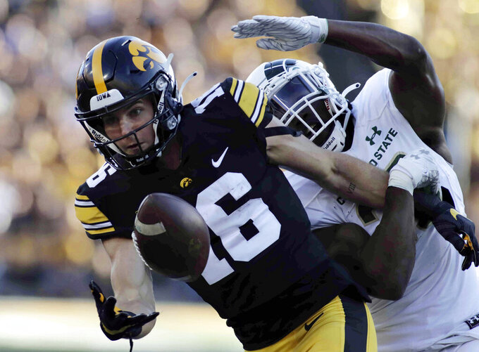 Iowa wide receiver Charlie Jones (16) tries to get a hand on this pass reception as Colorado State defensive back Marshaun Cameron (26) defends during the second half of an NCAA college football game, Saturday, Sept. 25, 2021, in Iowa City, Iowa. (AP Photo/Ron Johnson)