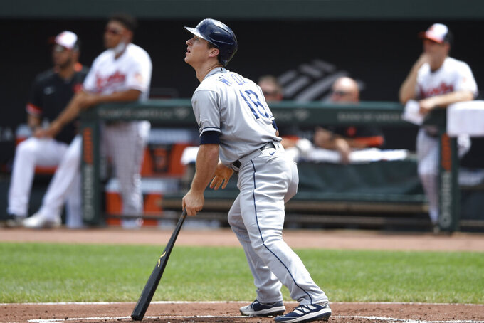 Tampa Bay Rays' Joey Wendle watches his RBI-single against the Tampa Bay Rays in the first inning of baseball game, Sunday, Aug. 29, 2021, in Baltimore. (AP Photo/Gail Burton)