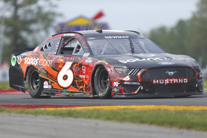 Ryan Newman drives through the Bus Stop during a NASCAR Cup Series auto race in Watkins Glen, N.Y., on Sunday, Aug. 8, 2021. (AP Photo/Joshua Bessex)