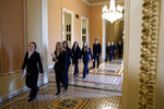 Senate pages walk toward the Senate chamber Monday, Jan. 27, 2020, on Capitol Hill in Washington, before the impeachment trial of President Donald Trump on charges of abuse of power and obstruction of Congress. (AP Photo/ Jacquelyn Martin)
