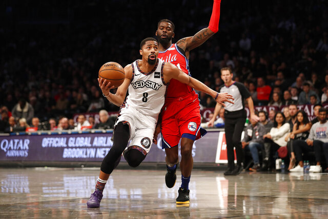 Brooklyn Nets guard Spencer Dinwiddie (8) drives against Philadelphia 76ers forward James Ennis III during the second quarter of an NBA basketball game at Barclays Center, Sunday, Dec. 15, 2019, in New York. (AP Photo/Michael Owens)