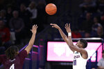 Gonzaga guard Joel Ayayi (11) shoots over Texas Southern guard Bryson Etienne (4) during the second half of an NCAA college basketball game in Spokane, Wash., Wednesday, Dec. 4, 2019. Gonzaga won 101-62. (AP Photo/Young Kwak)