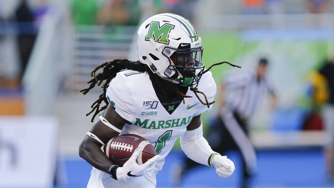 Marshall wide receiver Willie Johnson (1) returns a kickoff during the first half of an NCAA college football game against Boise State in Boise, Idaho, Friday, Sept. 6, 2019. (AP Photo/Otto Kitsinger)