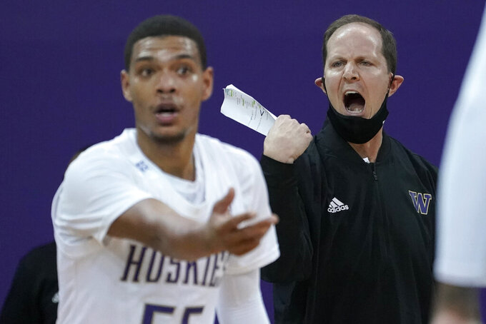 Washington coach Mike Hopkins reacts from the bench as he watches guard Quade Green, left, during the first half of the team's NCAA college basketball game against Southern California, Thursday, Feb. 11, 2021, in Seattle. (AP Photo/Ted S. Warren)