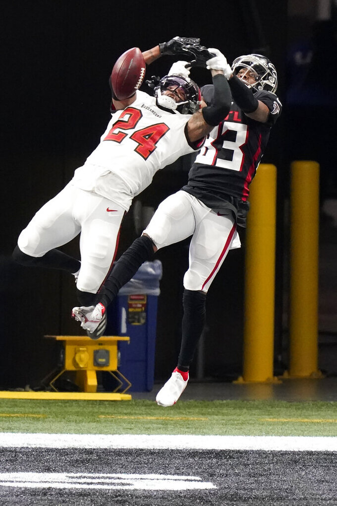 Tampa Bay Buccaneers cornerback Carlton Davis (24) breaks a pass in the end zone intended for Atlanta Falcons wide receiver Russell Gage (83) during the first half of an NFL football game, Sunday, Dec. 20, 2020, in Atlanta. (AP Photo/Brynn Anderson)